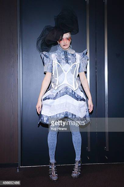 Cindy wears a dress by Alice Auaa at MercedesBenz Fashion Week Tokyo Autumn/Winter 2014 at Shibuya Hikarie on March 22 2014 in Tokyo Japan
