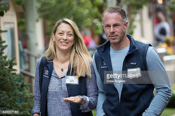Cindy Wenig walks with husband Devin Wenig chief executive officer of eBay as they attend the annual Allen Company Sun Valley Conference July 6 2016...