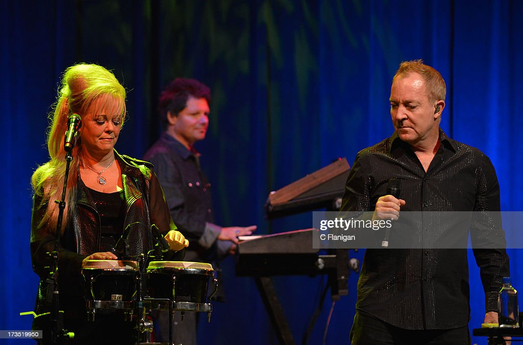 Cindy Wilson and Fred Schneider of The B-52's perform at The Fillmore on July 15, 2013 in San Francisco, California.