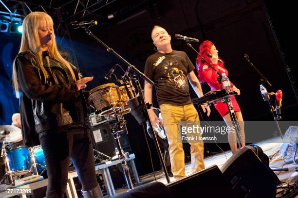 Cindy Wilson Fred Schneider and Kate Pierson of The B52's perform live during a concert at the Huxleys on August 21 2013 in Berlin Germany