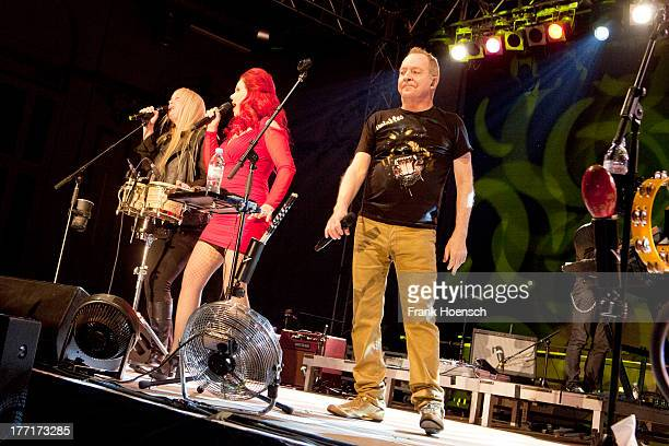 Cindy Wilson Kate Pierson and Fred Schneider of The B52's perform live during a concert at the Huxleys on August 21 2013 in Berlin Germany