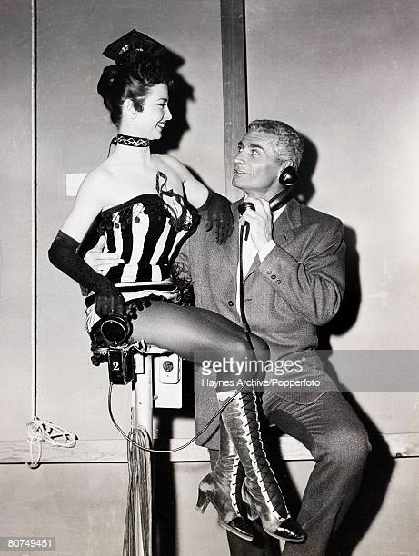 Cinema A picture of the American film actor Jeff Chandler pictured in Hollywood with a pretty show girl