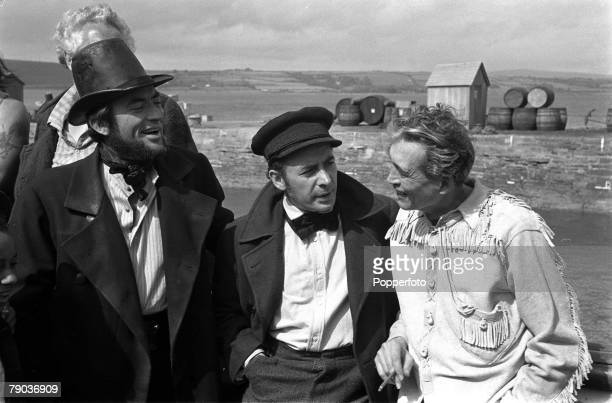 "Cinema Actors L-R: Gregory Peck and Leo Genn talk with legendary American director John Huston on the set of the film ""Moby Dick"""
