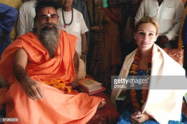 US cinema actress Julia Roberts poses with Indian priest Swami Dharmdev in Hari Mandir Ashram in Pataudi some 80kms southwest of New Delhi on...