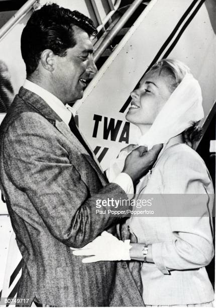 Cinema American entertainer Dean Martin pictured with his wife Jeanne Bieger after arriving in New York 27th May 1957