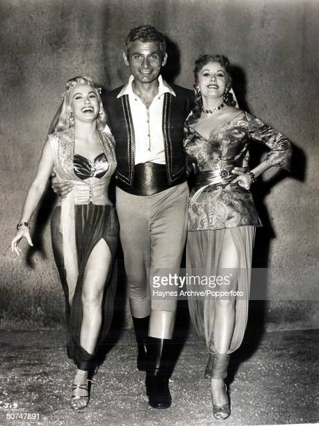 "Cinema, American film actors l-r, Rhonda Fleming, Jeff Chandler, and Mamie Van Doren on the Hollywood set of the film ""Yankee Pasha"", 1955"