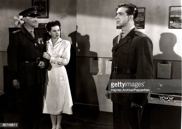 Cinema American film actors lr Russell Hicks Maureen O'Hara and John Payne in a still from the film ' To The Shores Of Tripoli' 1941