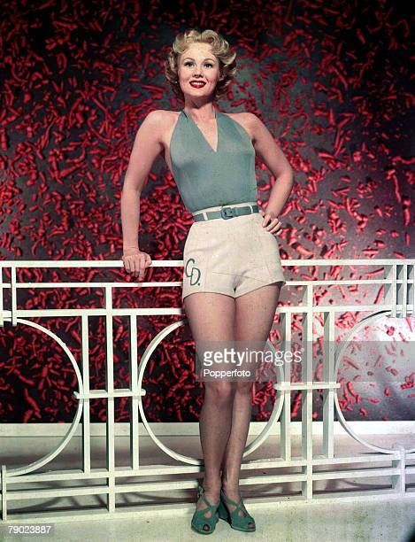 Cinema American stage and screen actress Virginia Mayo wearing shorts and plunge neck top Circa 1958
