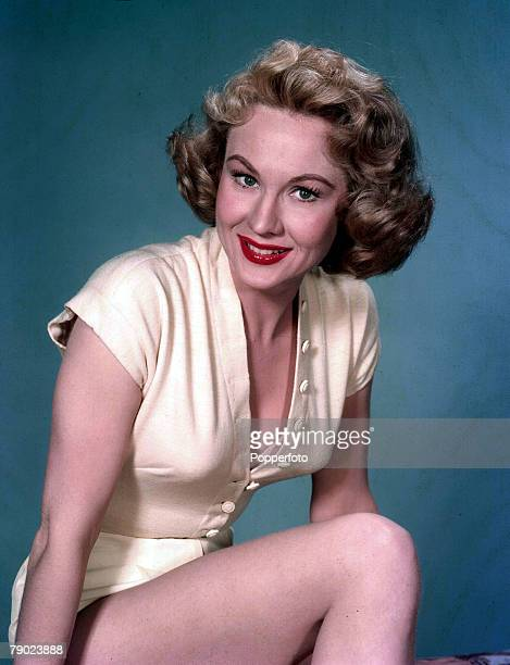 Cinema American stage and screen actress Virginia Mayo wearing yellow outfit Portrait Circa 1955