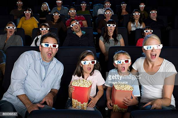 a cinema audience watching a 3d movie - 3d mom son stock photos and pictures