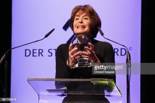 Cinema Award winner Thekla Carola Wied poses with her trophy during the Steiger Award on at Coal Mine Hansemann 'Alte Kaue' March 25 2017 in Dortmund...