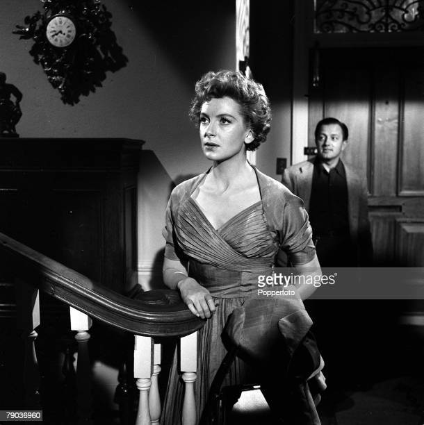 """Cinema British actress Deborah Kerr is pictured on the set of the film """"End of the Affair"""", in the background is producer Edward Dmytryk"""