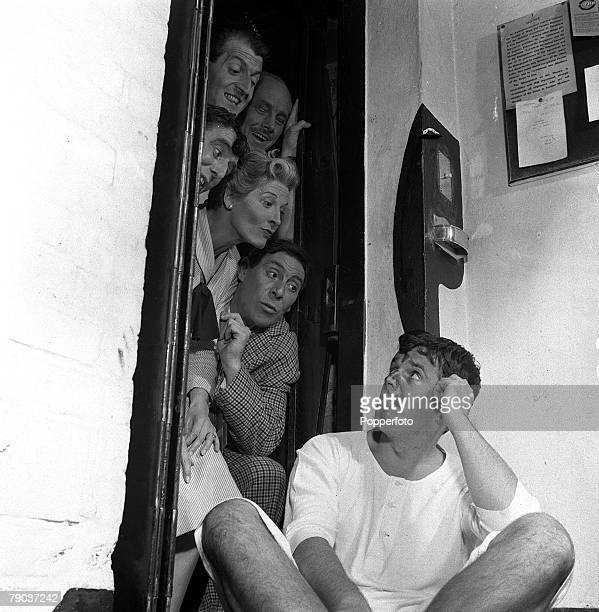 Cinema England Brian Rix sits in the foreground with the cast of the film Dry Rot from top LR John Chapman Charles Cameron Basil Lord Cicely...