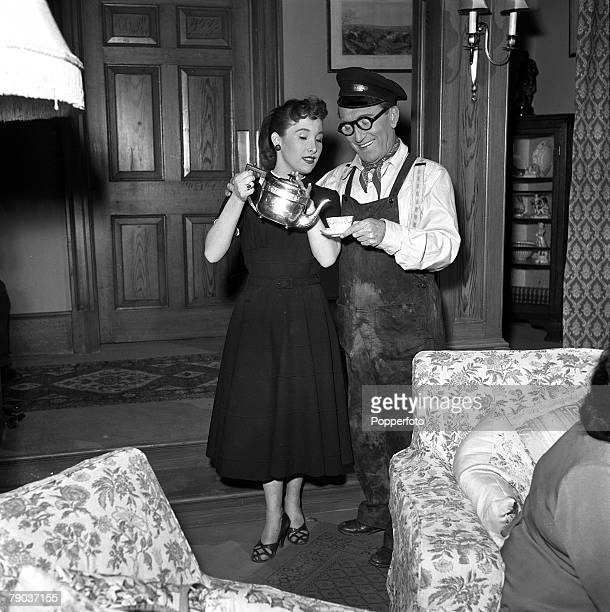 Cinema England British actor and comedian Arthur Askey is pictured with his daughter Anthea on the set of the film 'The Love Match'