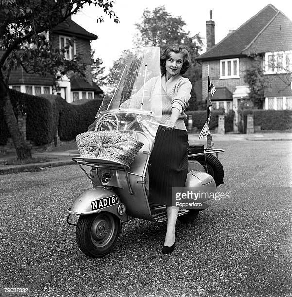 Cinema England British actress Maureen Davis is pictured sitting on her Vespa scooter on her way to do some shopping