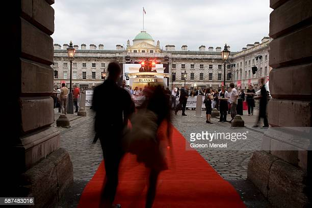 Cinema fans enter the unique red carpet entrance to Somerset House... News Photo | Getty Images