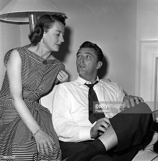 Cinema London England American actor Robert Mitchum is pictured with his wife Dorothy on their first visit to Britain