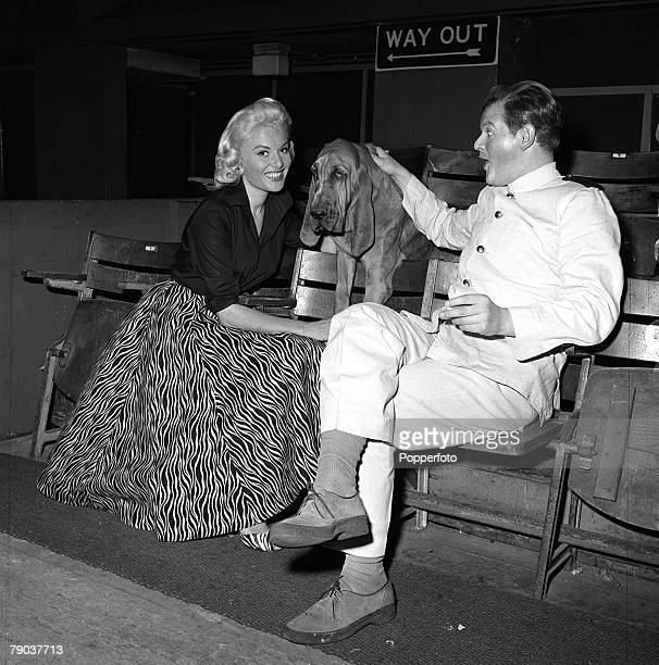 Cinema London England British actor comedian and entertainer Benny Hill is pictured with actress Belinda Lee and a Bloodhound dog on the set of the...