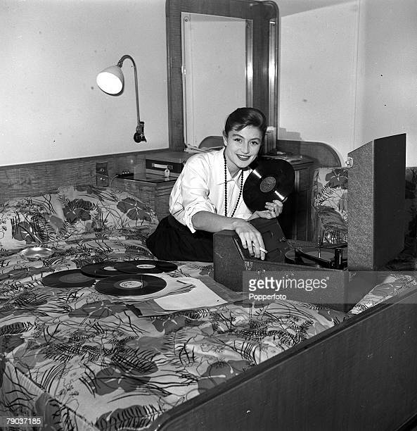 Cinema London England French actress Anouk Aimee is pictured playing music on a record player in her room at the Savoy Hotel
