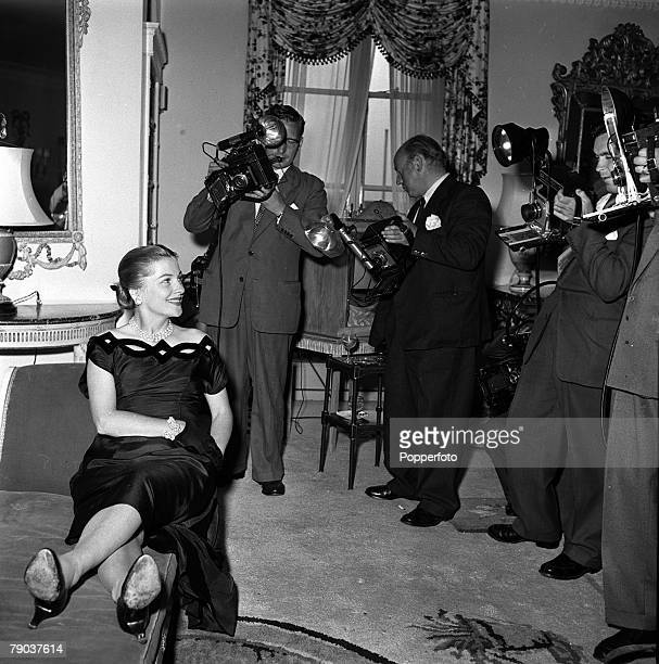 Cinema London England Japanese born American actress Joan Fontaine is photographed by press photographers at a reception prior to filming the movie...
