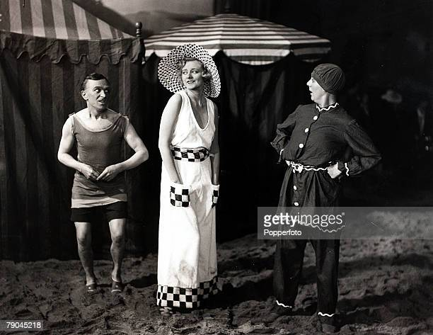 circa 1935 British actress Evelyn Lane pictured with admirers on an Elstree Studios film set