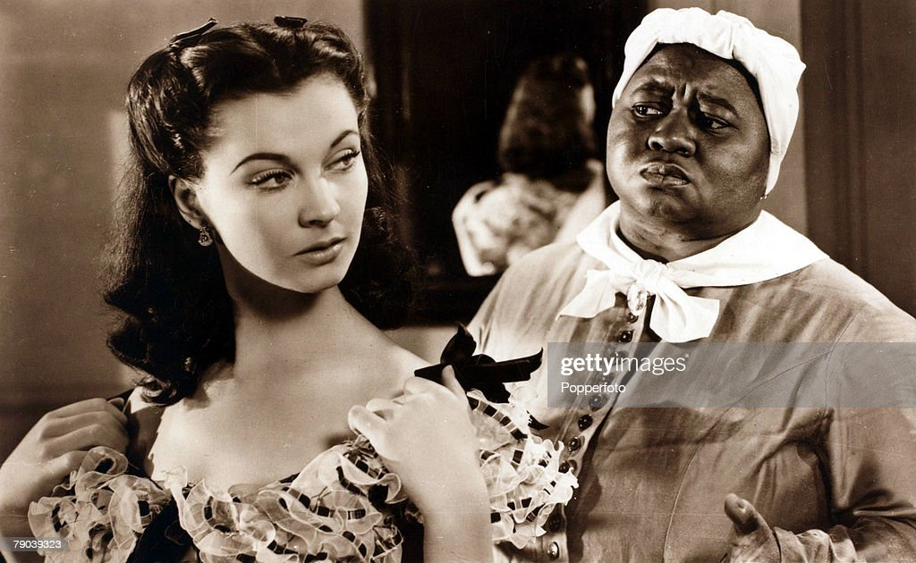Cinema. Personalities. 1939. English actress Vivien Leigh playing Scarlett O'Hara in the 1939 classic film 'Gone With The Wind' alongside actress Hattie McDaniel. : News Photo
