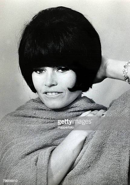 13th July 1963 French film actress Brigitte Bardot pictured wearing a black wig for playing a scene in the film 'A Ghost At Noon' Brigitte Bardot...