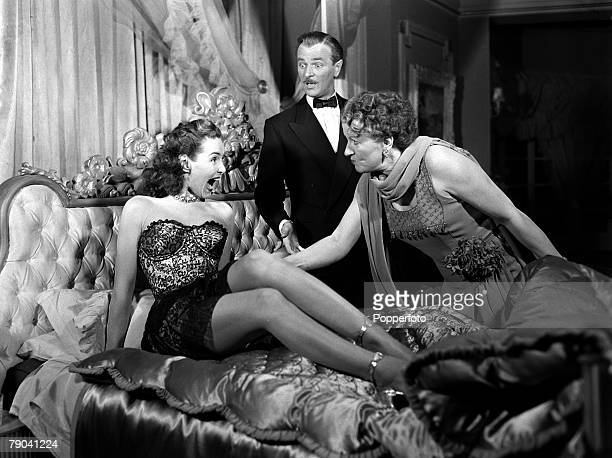 1949 Patricia Roc Nigel Patrick and Phillipa Gill in a scene from the film Perfect Lady