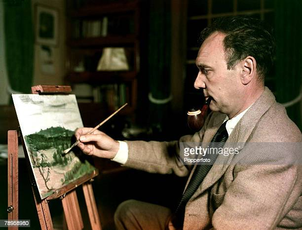 1951 Renowned English actor Ralph Richardson painting at his home