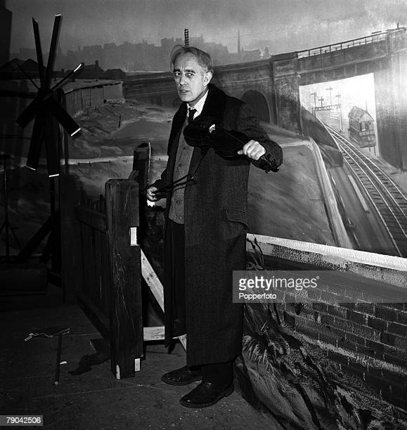1955 English actor Alec Guinness is pictured during the making of the film 'The Lady Killers'