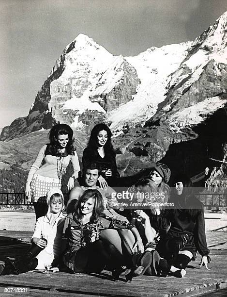 22nd October 1968 Switzerland Actor George Lazenby in a break from filming the James Bond film 'On Her Majesty's Secret Service' surrounded by...