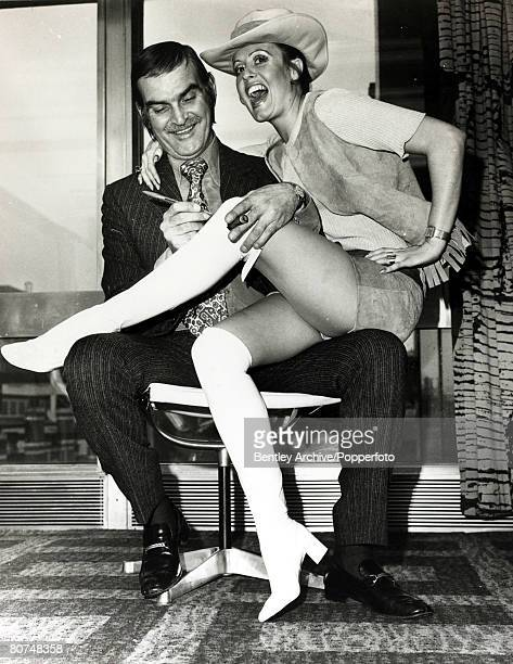23rd March 1970 Welsh actor Stanley Baker signing his autograph for model Susan Shaw at a Ladies Fashion Luncheon in Manchester He started making...