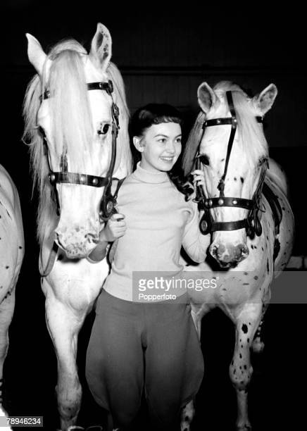 26th November 1954 Sixteen year old British actress Janette Scott pictured at London's Olympia with two circus horses