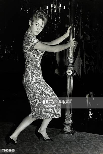 28th October 1956 French film actress Brigitte Bardot pictured practicing her curtsey for a Royal Film Performance in London Brigitte Bardot first...