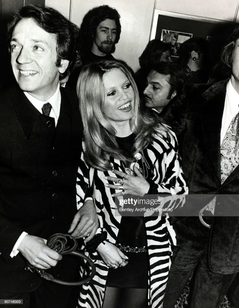 """Cinema Personalities pic: 5th February 1970. French actress Brigitte Bardot, (born 1934), pictured at the Paris film premiere of the film """"The Bear and the Bull"""" with her co-star Jean-Pierre Cassel. Brigitte Bardot, first appeared on screen in 1952, marr : News Photo"""