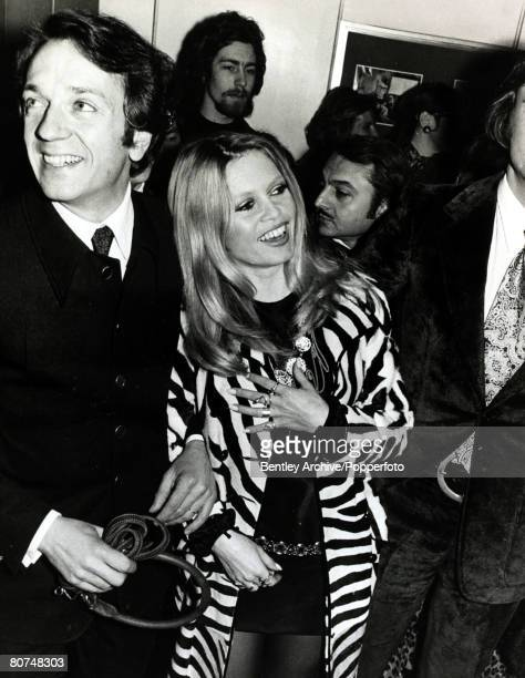 5th February 1970 French actress Brigitte Bardot pictured at the Paris film premiere of the film 'The Bear and the Bull' with her costar JeanPierre...