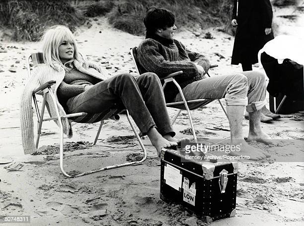 6th September 1966 French actress Brigitte Bardot on the beach at North Berwick with her costar Laurent Terzieff as they brave the cold while filming...