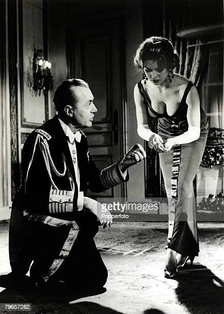 7th May 1957 French film actress Brigitte Bardot pictured with Charles Boyer in a scene from the film 'La Parisienne' Brigitte Bardot first appeared...