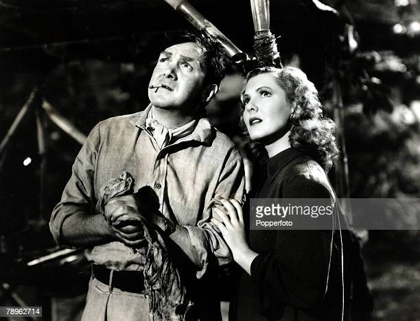 circa 1939 American actress Jean Arthur is pictured playing alongside Thomas Mitchell in the film Only Angels Have Wings