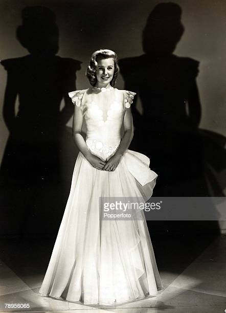 circa 1940's American actress June Allyson born 1917 wearing a dress of white organza June Allyson especially popular in the 1940's often appeared as...