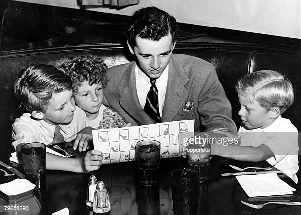 circa 1940's Freddie Bartholomew pictured at the time he was serving with the American Army Air Corps is seen talking with 3 refugee children from...