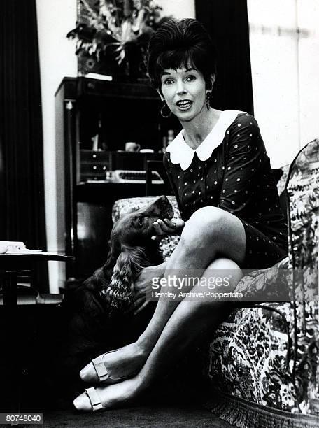 circa 1950's British actress Dawn Adams with her dog Lucky at her Belgravia flat