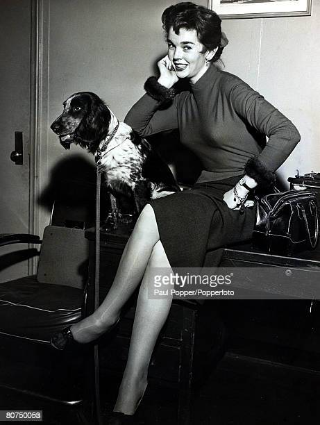 circa 1950's British actress Dawn Addams with her dog Whistler awaiting a flight to Rome
