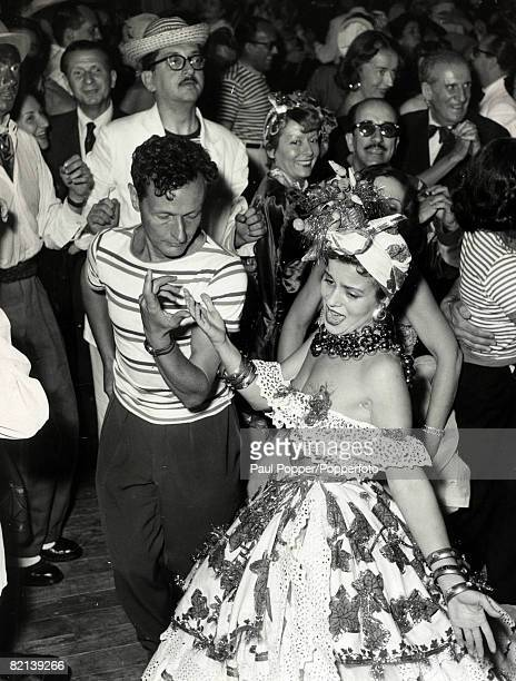 circa 1950's French actor Jean Louis Barrault dances with Ruth Prado at a Rio Carnival theme evening near Paris