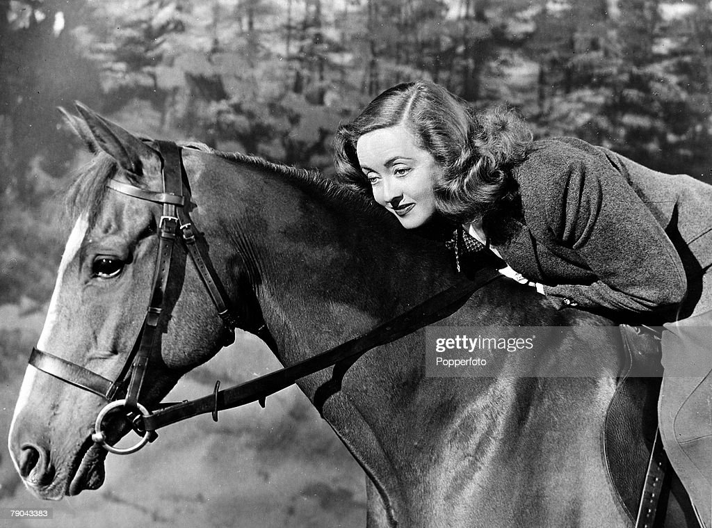 """Cinema Personalities. pic: circa 1952. American film actress Bette Davis is pictured riding a horse in a scene from the film """"Another Man's Poison"""". : News Photo"""
