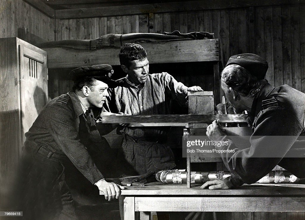 Cinema Personalities, pic: circa 1963, British actor Richard Attenborough (left) with James Coburn (centre) and Gordon Jackson in the film 'The Great Escape' : News Photo