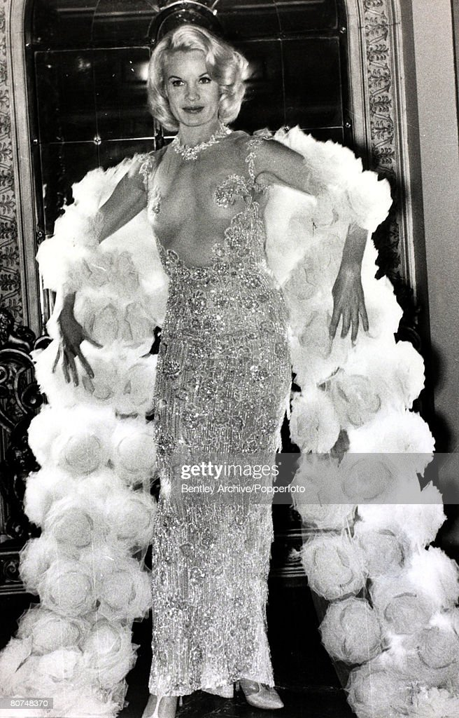 """Cinema Personalities pic: circa 1964. American actress Carroll Baker, born 1931, at the premiere at the Plaza Theatre, London for her film """"The Carpetbaggers"""" wearing a ·17,000 transparent dress. : News Photo"""
