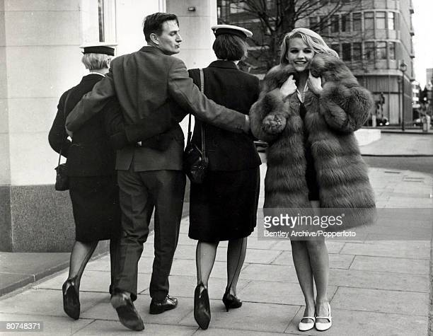 circa 1964 American actress Carroll Baker born 1931 looking glamorous in London as she catches the eye of a man out walking with two Wrens