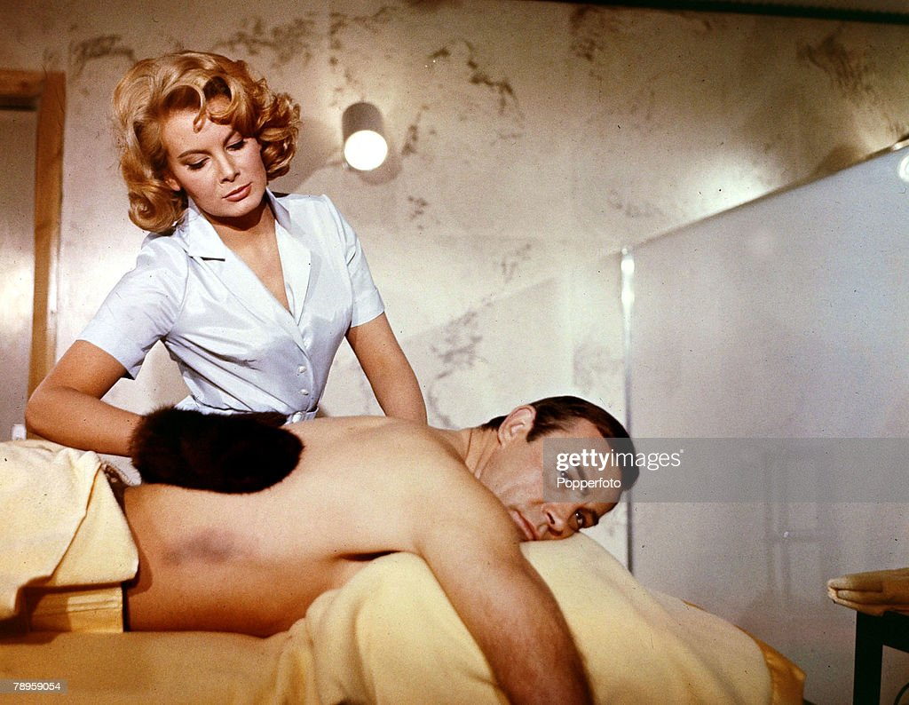 Cinema Personalities, 1965, Scottish actor Sean Connery, born 1930,playing a typical scene as '007' in the James Bond film 'Thunderball', as Molly Peters provides the massage