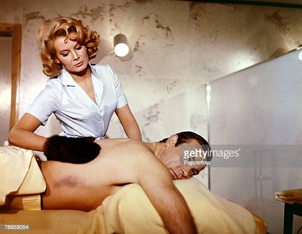Cinema Personalities Scottish actor Sean Connery born 1930playing a typical scene as '007' in the James Bond film 'Thunderball' as Molly Peters...